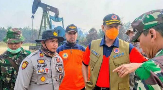 Kepala Badan Nasional Penanggulangan Bencana (BNPB) Doni Monardo melakukan kunjungan kerja dengan agenda pemantauan lapangan langsung kebakaran hutan dan lahan di Provinsi Riau, Rabu (11/9).