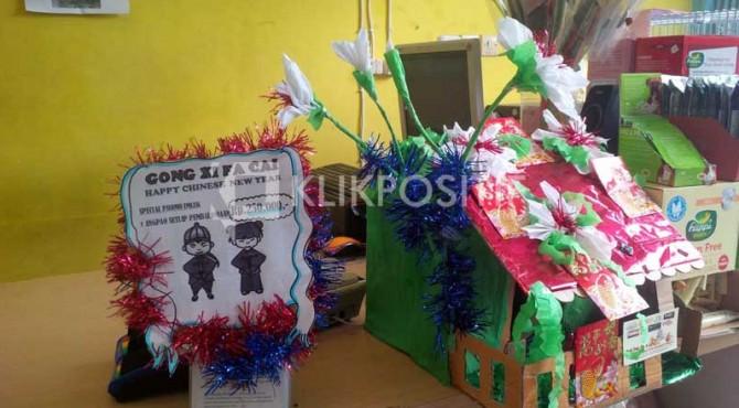 Angpao untuk para pelanggan petshop di Bali dalam rangka Imlek.