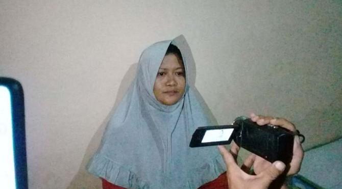 Ibu TR, Yulida Dawiga(34)