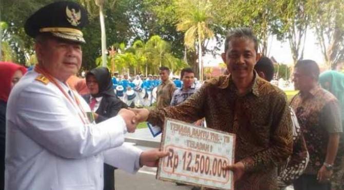 Tajuzzaky, petugas THL-TBPP yang mendapatkan prestasi di Tingkat Provinsi Sumatera Barat sebagai Juara I THL-TBPP Teladan Tahun 2019.