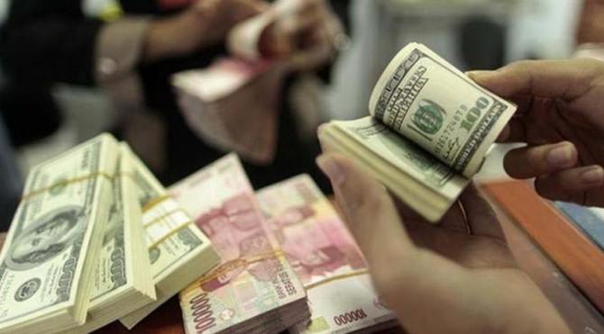 Nilai tukar Rupiah terhadap dolar Amerika menguat pagi ini, Jumat (15/4)