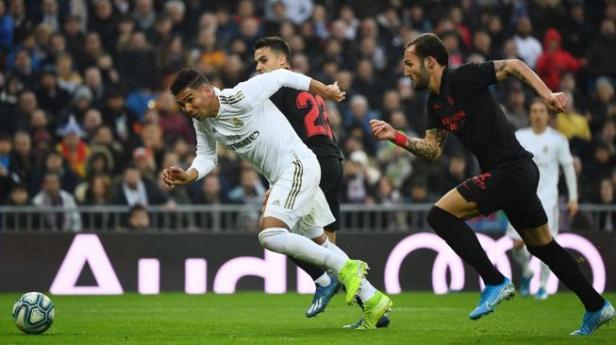 Madrid mengalahkan Sevila dengan skor 2-1