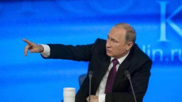 Presiden Rusia Vladimir Vladimirovich Putin saat jumpa pers dalam acara perdagangan internasional di Moskow pada 18 December 2014