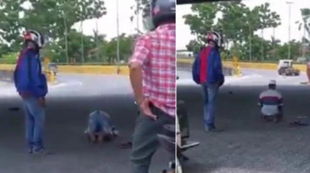Seorang pria di Malaysia salat di tengah jalan