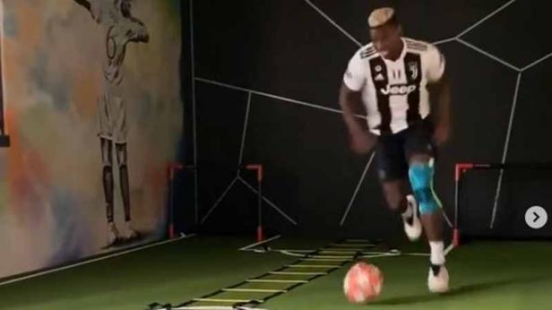 Paul Pogba mengunggah video latihan mengenakan jersey Juventus.