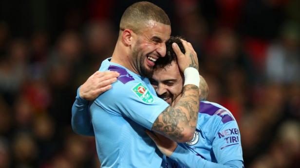 Pemain Manchester City selebrasi usai membobol gawang MU