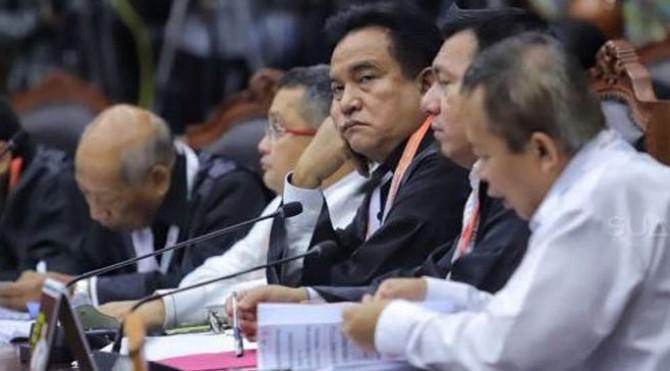 Suasana sidang perdana Perselisihan Hasil Pemilihan Umum (PHPU) sengketa Pilpres 2019 di Mahkamah Konstitusi, Jakarta, Jumat (14/6).