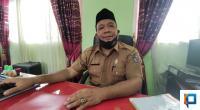 Kepala SMPN 1 Kecamatan Harau M. Yusuf Lubis saat berada di ruangannya.