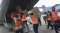 Petugas memasukkan logistik bantuan untuk korban gempa bumi Majene kedalam Pesawat Hercules A 1321 TNI AU, di Lanud Halim Perdanakusuma, Jakarta, Jumat (15/1/2021).