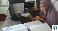 Fitri Arsih, Dosen UNP Saat Mempertahankan Disertasi Secara Online