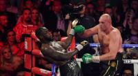 Petinju Inggris Tyson Fury (kanan) memberikan tekanan kepada juara bertahan kelas berat WBC, Deontay Wilder, dalam duel di MGM Grand Garden Arena, Las Vegas, AS, Sabtu (22/2/2020). Dalam duel itu Fury menang TKO ronde ketujuh atas Wilder.