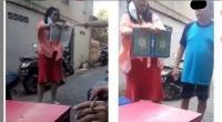 Wanita melempar Al Quran dan mengancam akan merobeknya.